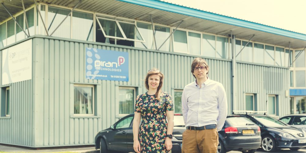 Daniel Pugh and Alex Pugh, directors of Piran Technologies standing in front of their business