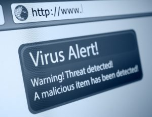 Picture shows a close up shot of a browser window on a computer. There is a pop up on the screen that says Virus Alert! Warning threat detected. A Malicious item has been detected.