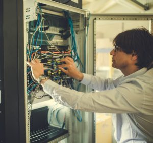 Director from Piran Technologies looking at wiring in a server box