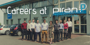 image shows the piran technologies stood outside their office smiling for the camera - over the image is the text careers at piran technologies